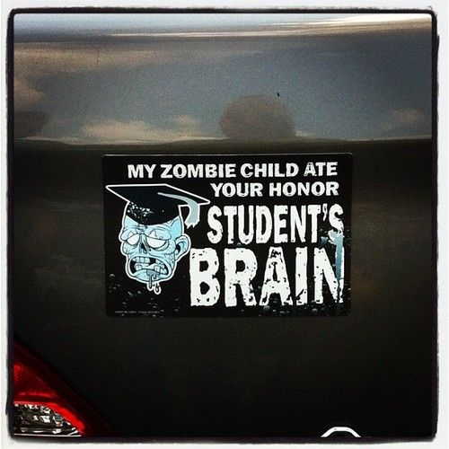 kristiannerice:  Bumper sticker at school #collegelife #humor #zombies #funny (Taken with Instagram)  Mmm. Honor student brain.
