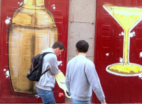 Madrid is known for its party-hearty lifestyle. Students walk by a martini mural in the historic city center.