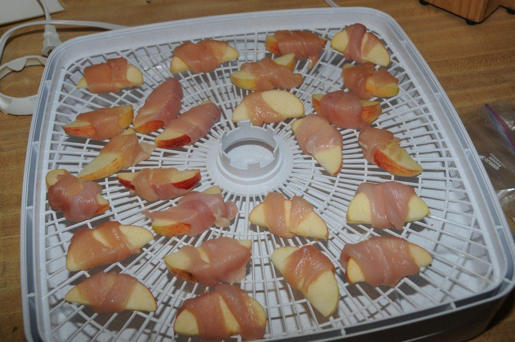 It S Easy To Make Your Own Chicken And Apple Dog Treats Just Slice The Apples Wrap Chicken Around Them And St Dog Food Recipes Homemade Dog Treats Dog Treats