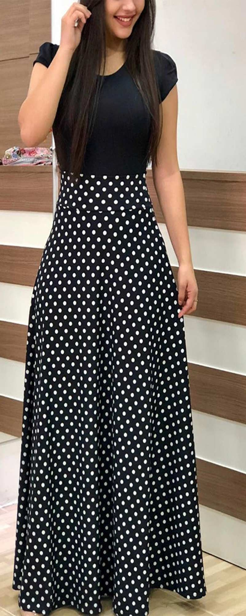 d91fa236a52a Long maxi dress with black short sleeves and white polka dots design. Such  a cute and safe outfit!