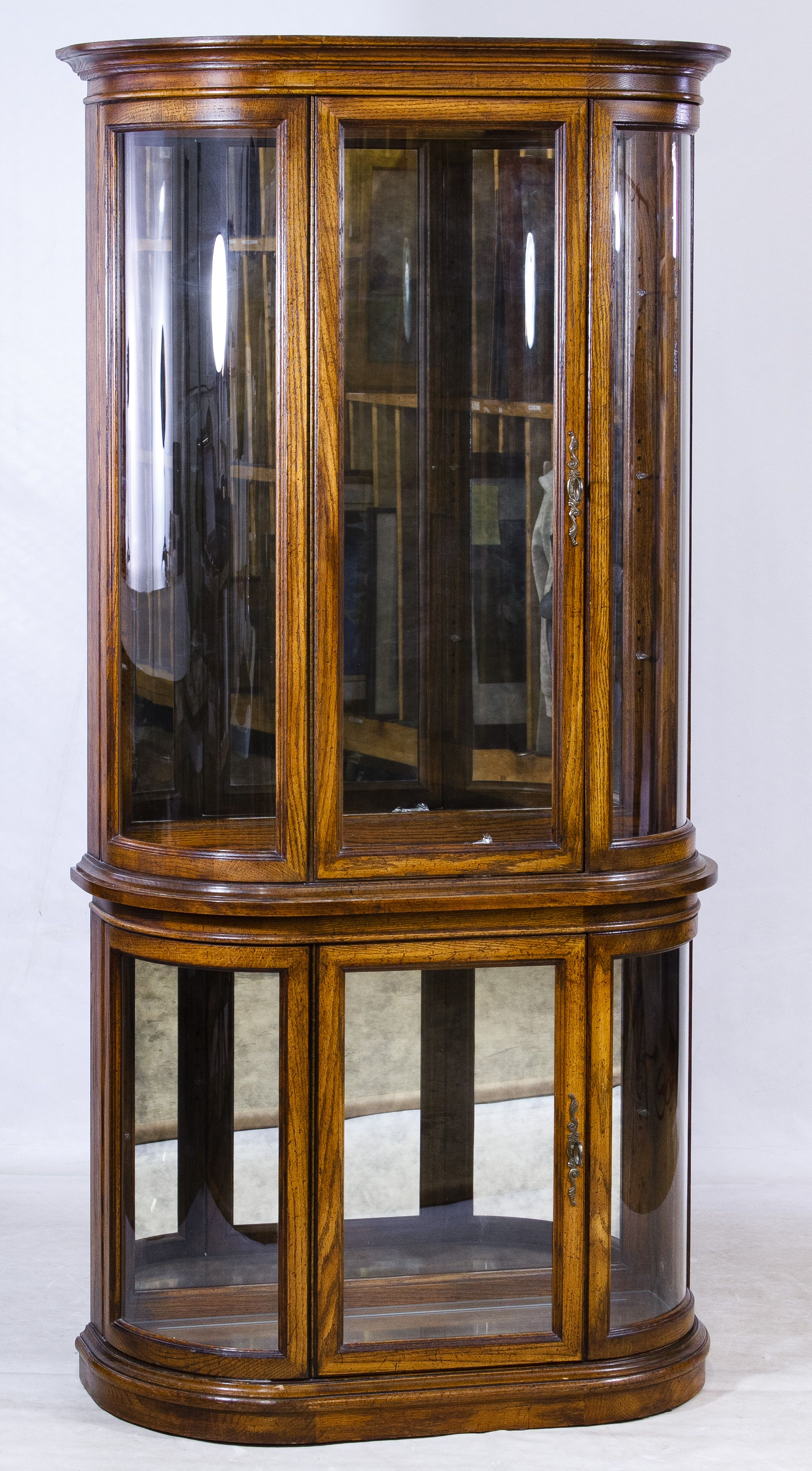 Lot 141 Oak Curved Glass Display Cabinet Two piece cabinet having