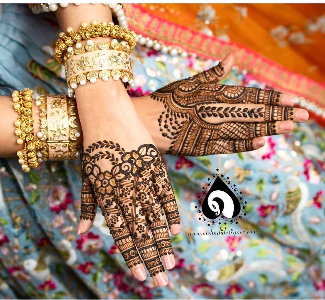 A mehndi design this pretty, you would definitely wish to add it to your post #quarantine bridal cart!❣️And of course, those enamelled kadas are worth crushing over!😍  #bride #bridetobe #bridalinspiration #mehndi #mehendi #mehandi #mehndidesigns #accessories #kada #bridalaccessories #backhandmehndi #henna #hennaart #mehndiartist #hennaartist #hennalove #hennainspiration #hennalookbook #mehndihenna #mehndibride #mehndiart #mehndiinspiration #bridalmehndi #bridalmehandi #bridalmehendi