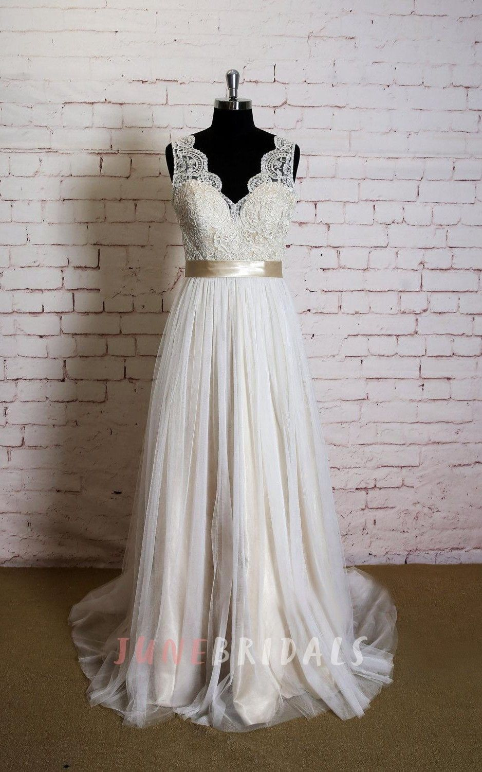 Vneck sleeveless lace top wedding dress with champagne lining