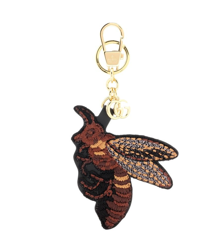 Gucci - Embroidered bag charm - Gucci re-imagines its favourite bee motif as a bag charm. Crafted from leather, it comes with intricate embroidery and golden chain for a luxe finish. Attach yours to a black leather bag. seen @ www.mytheresa.com