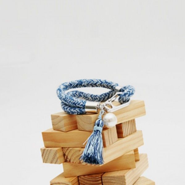 Today's Hot Pick :Braided Rope Bracelet with Tassel http://fashionstylep.com/P0000YZG/ju021026/out This braided rope bracelet will give your ensemble a beachy vibe regardless of where you are in the world. It features a braided rope cord in blue hue, a tassel and ivory pearl charm, and a lobster claw fastener. Wear this with a tank top and high-waisted denim shorts for a summery look.