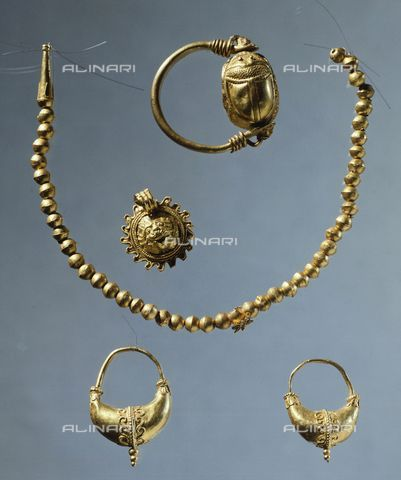 Title: Gold bead necklace, scarab ring, earrings and a gold crown, Goldsmith art, Greek Civilization, Taranto, Museo Archeologico Nazionale (Archaeological Museum), Credits: DeA Picture Library, licensed by Alinari