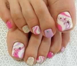 white with pink and purple swirls pedicure nail art design and diamantes
