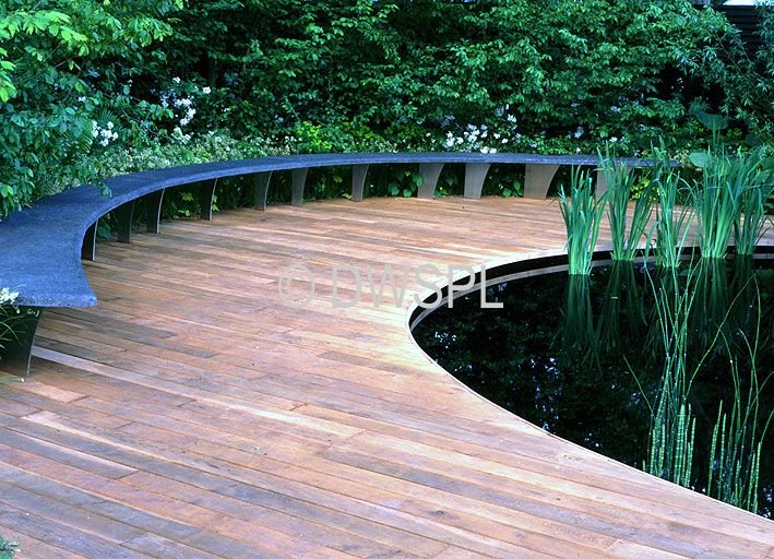 Timber decking surrounding large fish pond for the 39 pond for Garden decking with pond