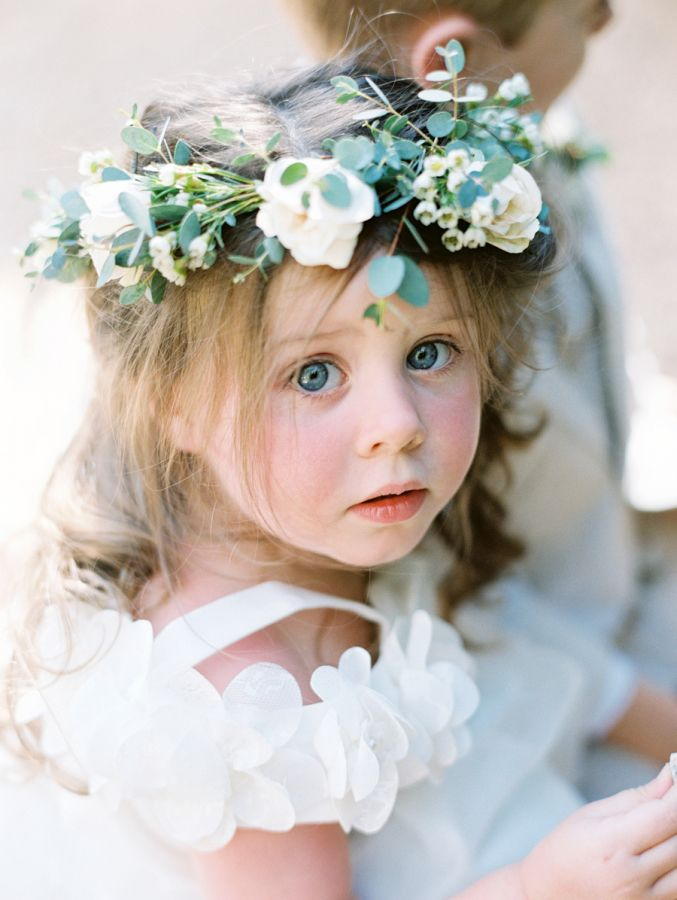 Flower girl with her gorgeous big blue eyes: http://www.stylemepretty.com/2016/11/22/natural-and-organic-same-sex-ojai-wedding/ Photography: Lavender and Twine - http://www.lavenderandtwine.com/