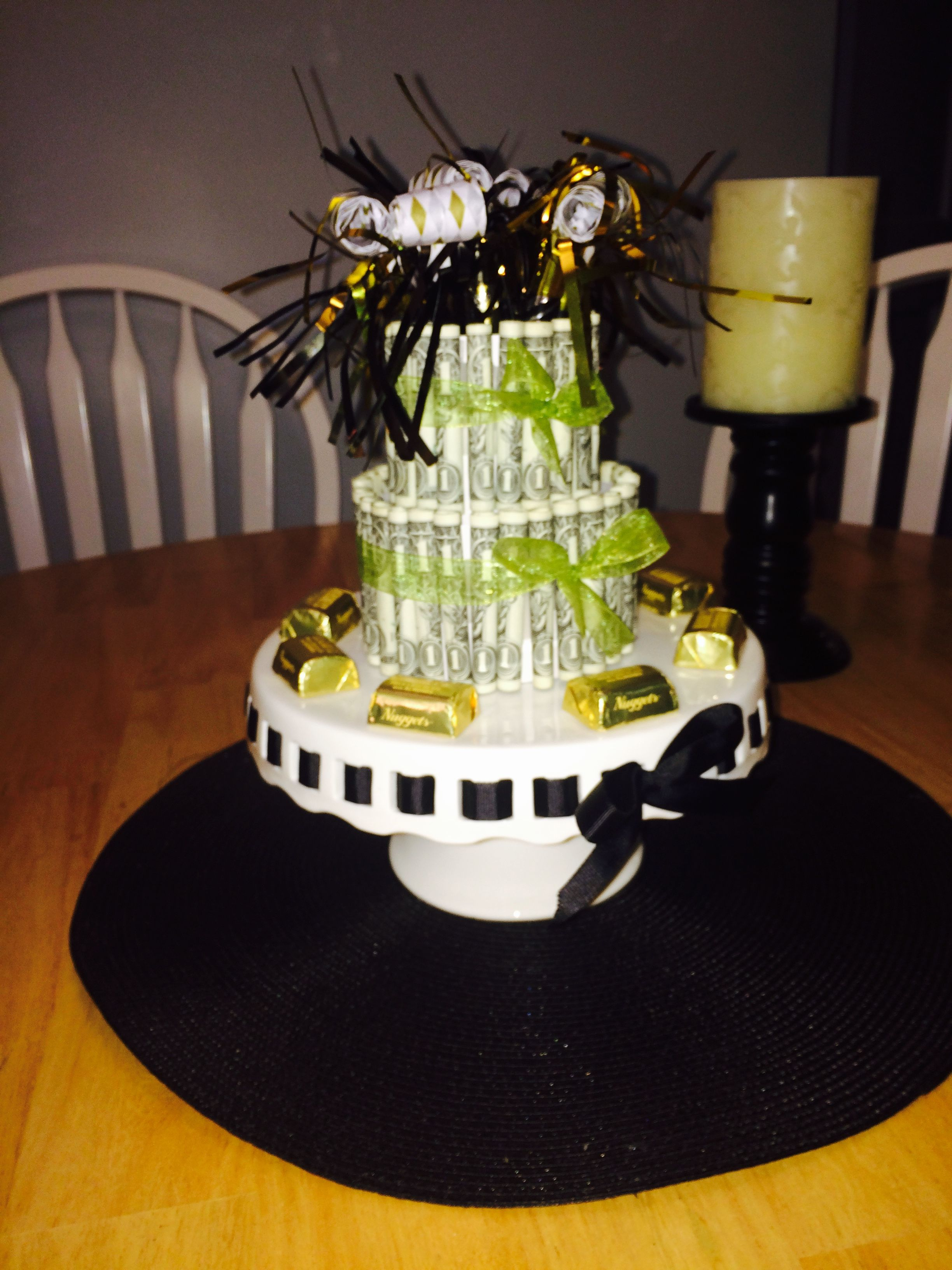 A 2 Tier 50th Birthday Cake Made From One Dollar Bills 30 On The Bottom And 20 Top Finish Look Off With Hershey Nuggets Encircling