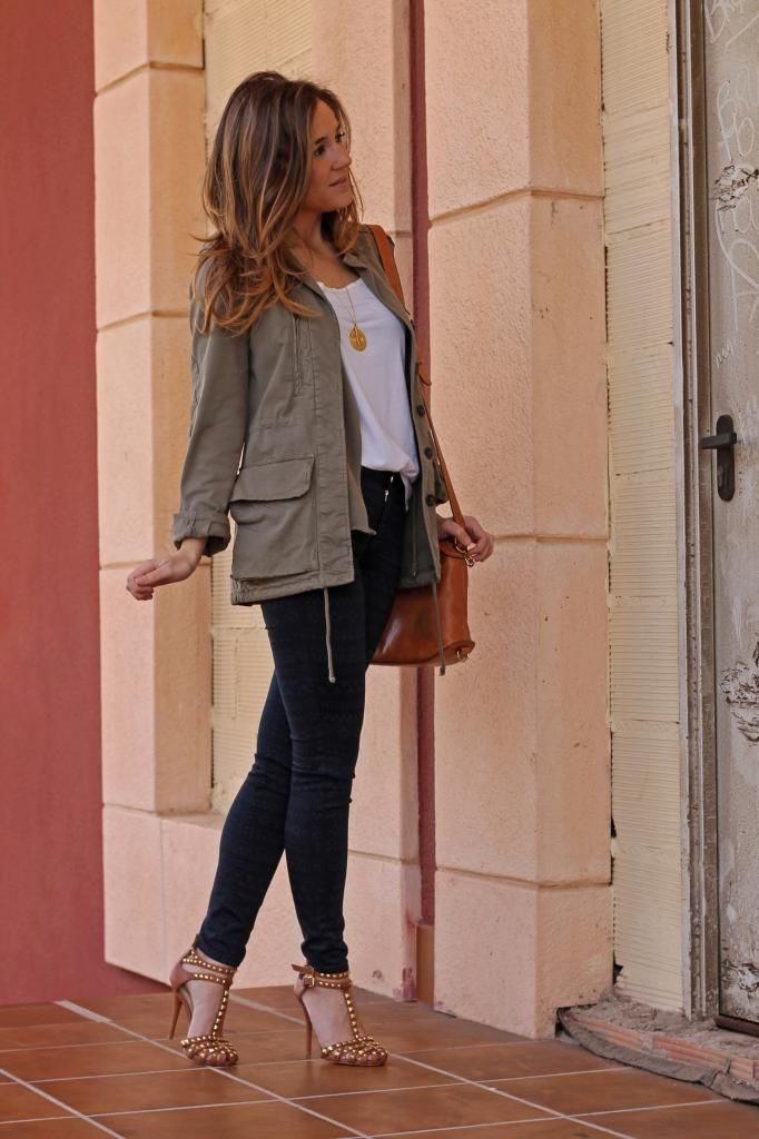 khaki anorak, white tee, dark skinnies, studded heels... I would rock flats instead. But amazing!