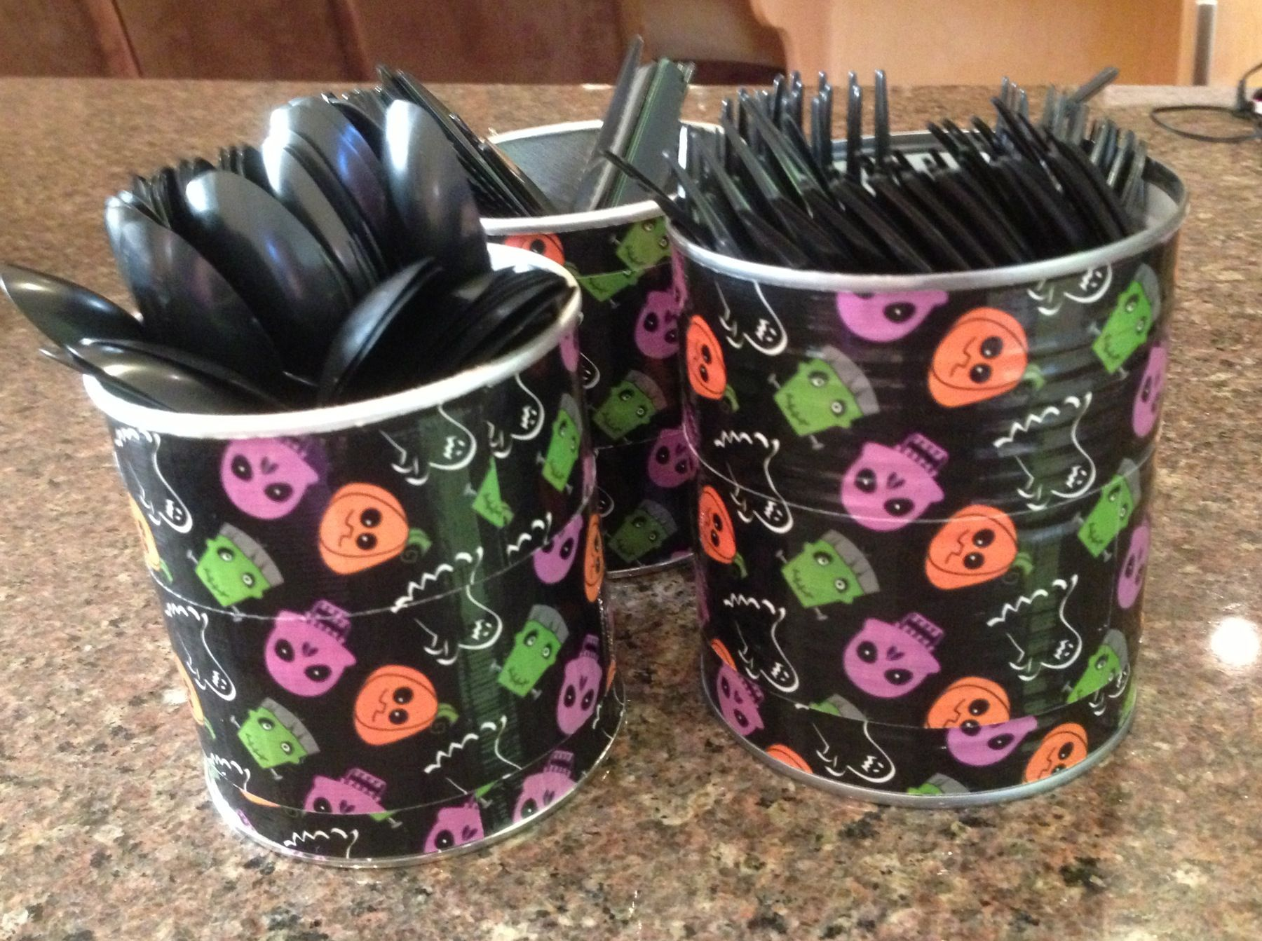 Duck tape on cans to hold utensils for Halloween party