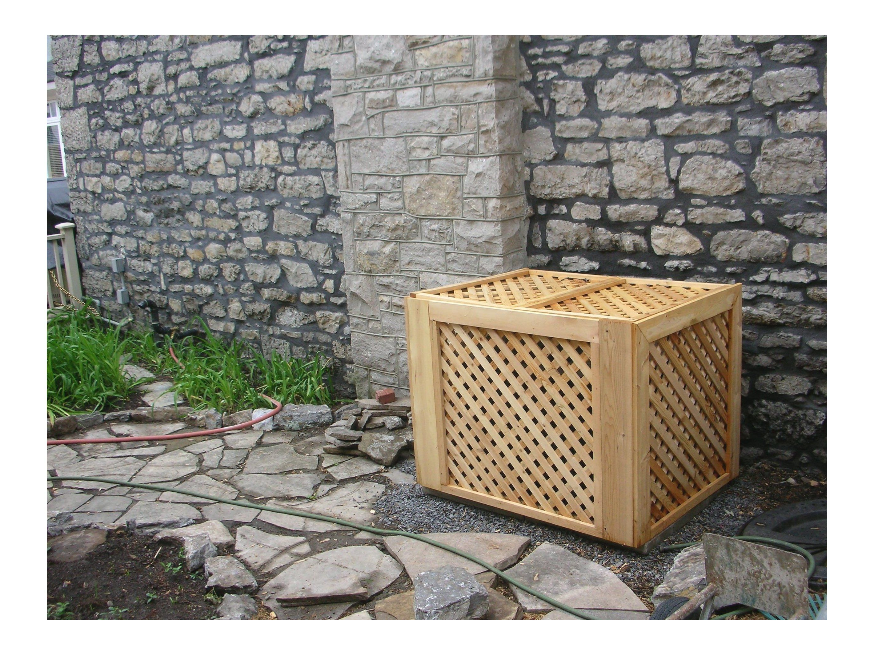 Hide the air conditioning unit with white cedar pre made