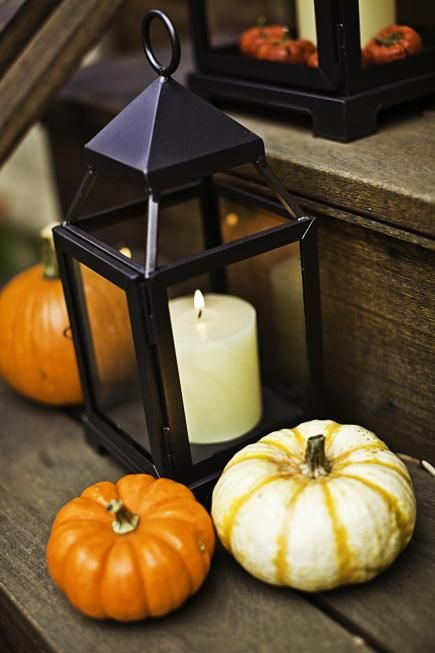 The rich colors of autumn set the tone for decorating with gourds leaves pumpkins