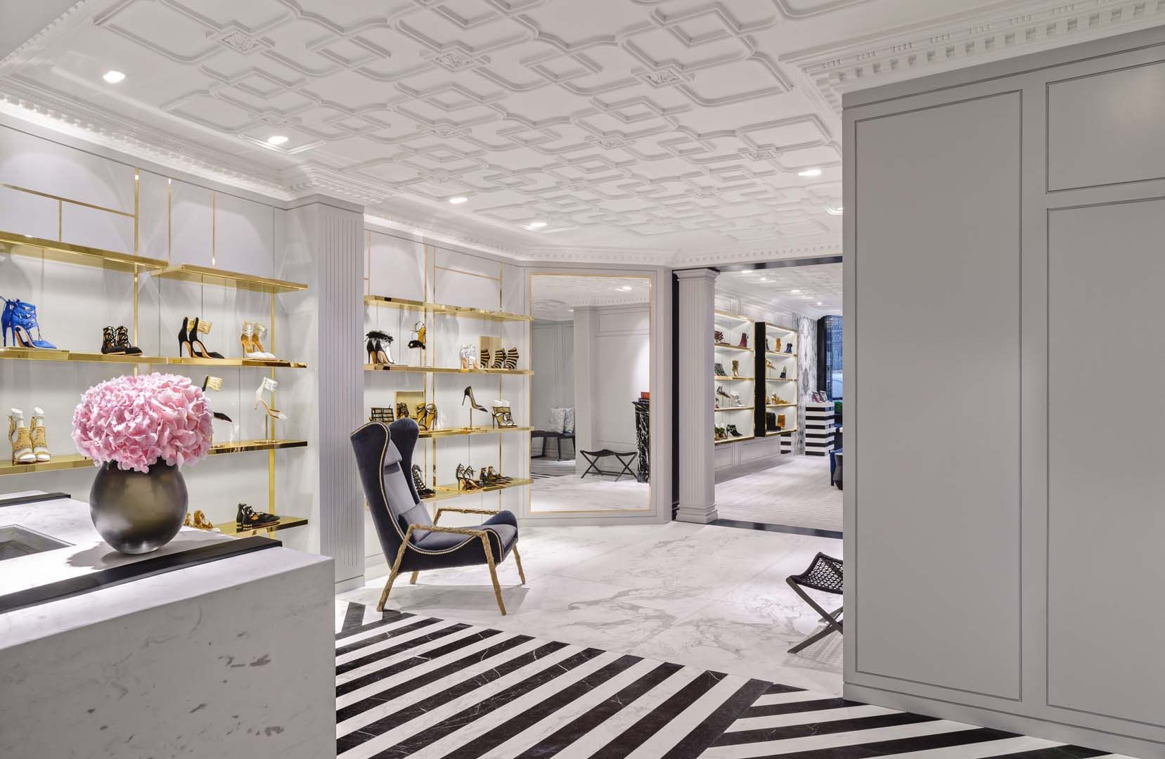 Aquazzura store in London Mayfair with interior design and architecture of  Casa do Passadiço. Black and white. Golden shelves. Straight lines. Shoe  store.