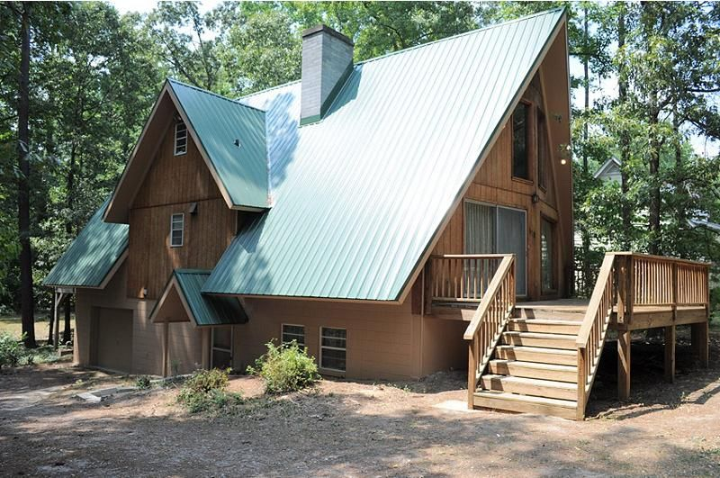 Cool a frame house with green metal roof home for Log cabin roof design