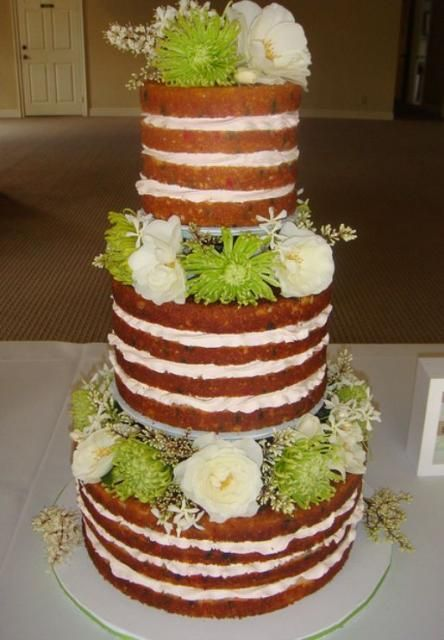Three Tier Multi Layered Cream Wedding Cake With Fresh Flowers Between