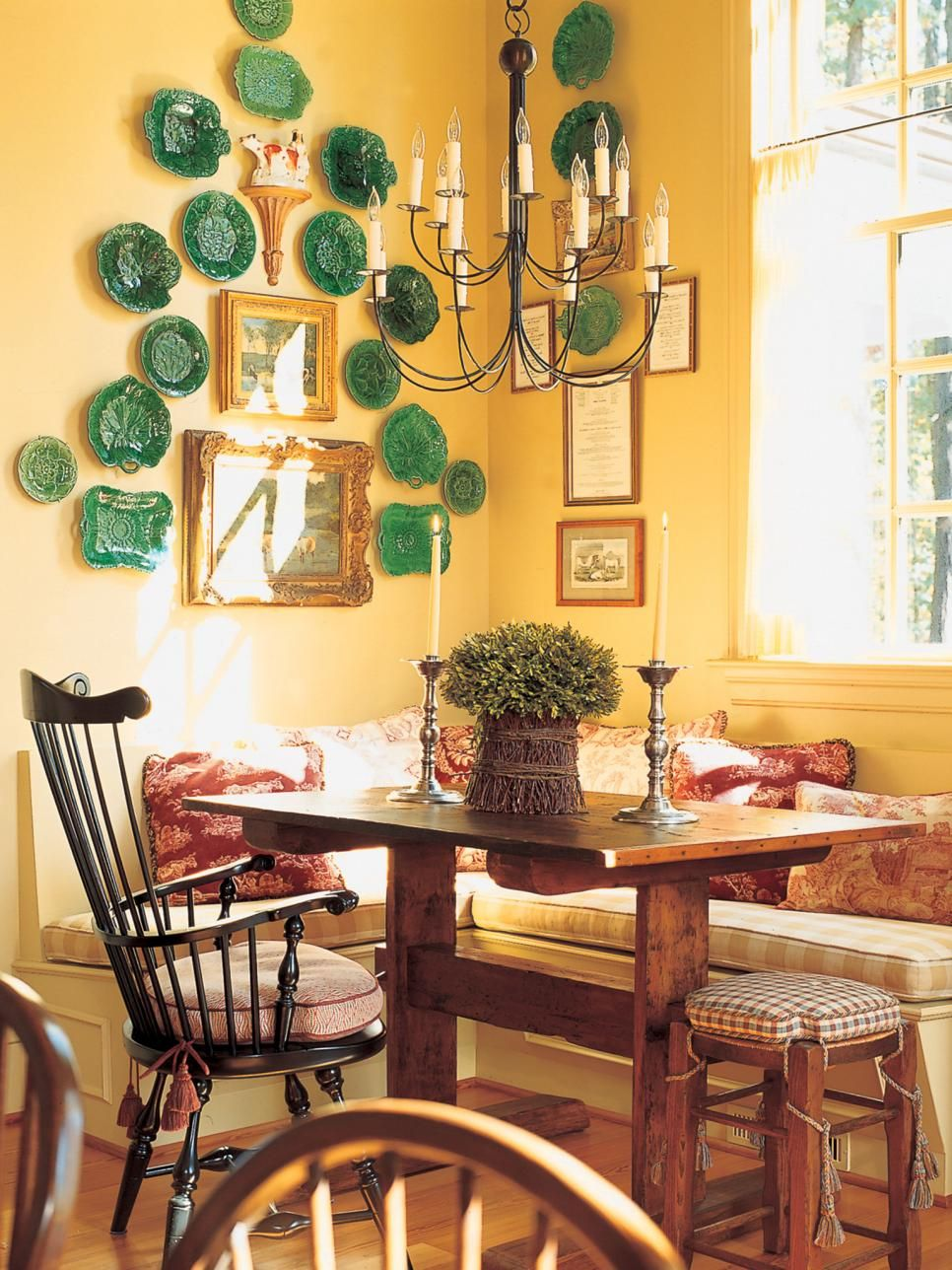 This high-ceiling dining room features a collection of green plates ...