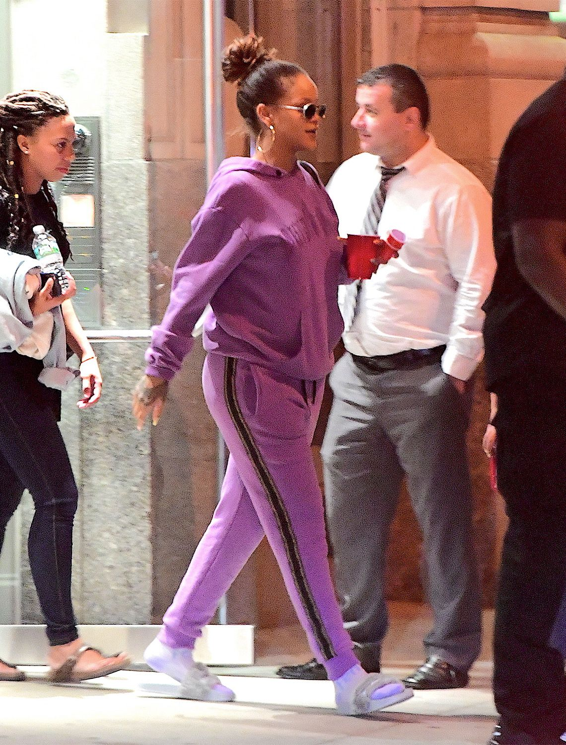 a2d72a8a5 9/12 Rihanna wore a purple sweatsuit by Palm Angels in New York ...