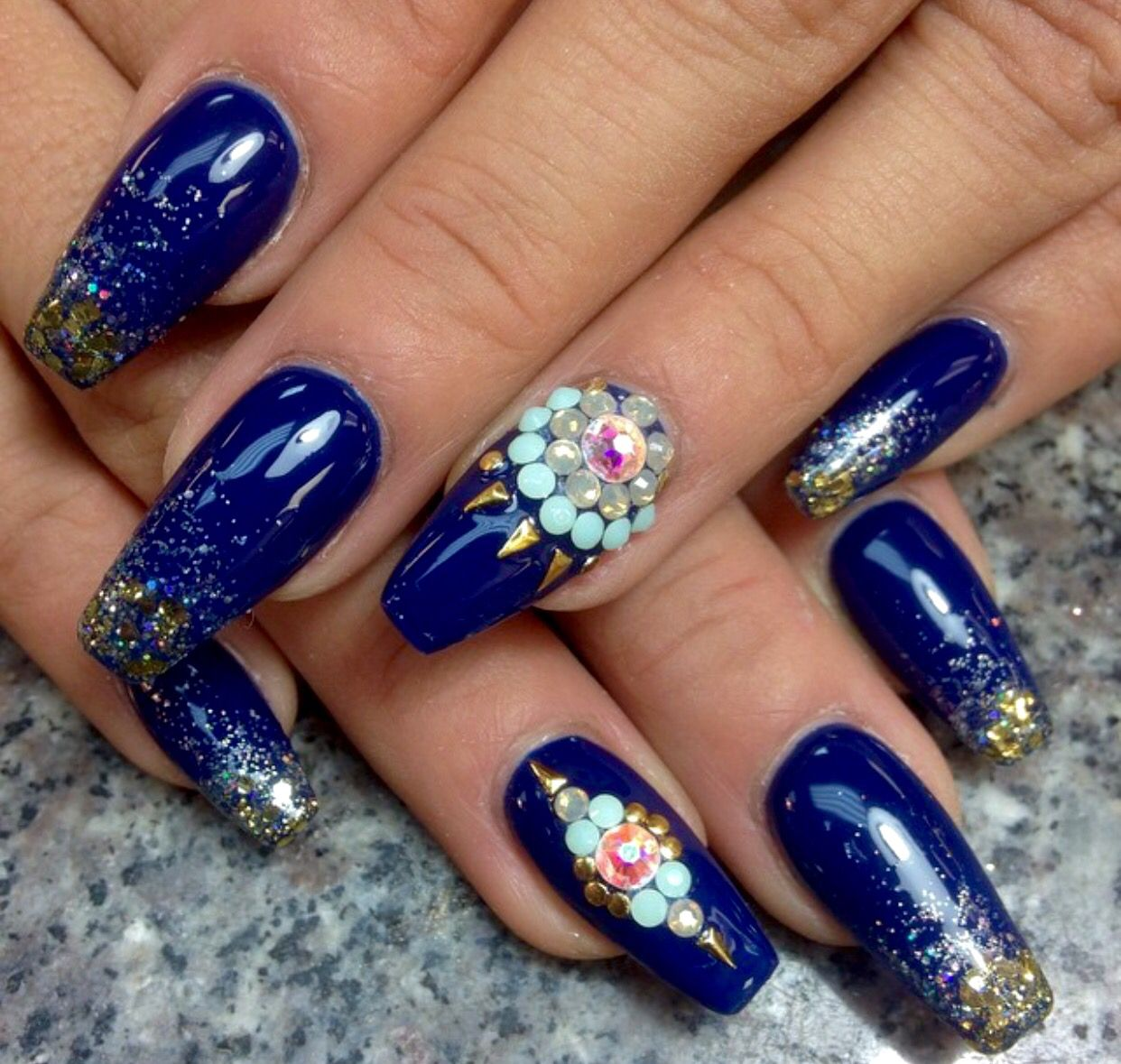 Without the gaudy jewel, these blue and gold coffin nails