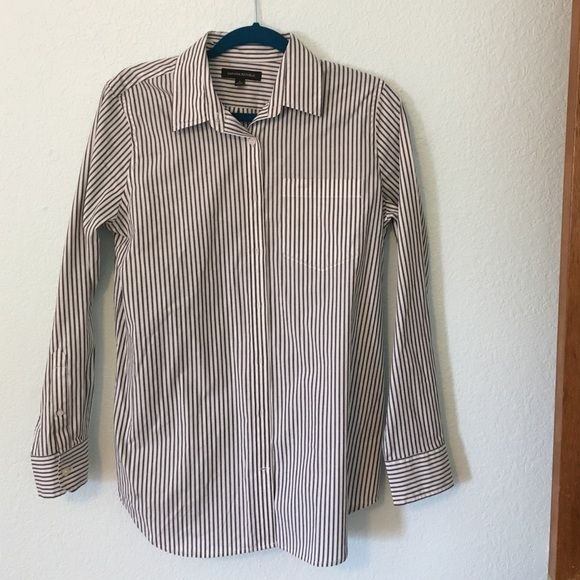 "NWOT Banana Republic Size Small Shirt Traditional front pocket, back pleat, cuffed button up shirt White with gray stripes. Sleeves 24"" long , center back 34"" long, and front across bust about 20"".  Very soft material with some stretch. Banana Republic Tops Button Down Shirts"
