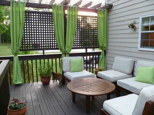 Trellis At The End Of Our Deck With Plants Growing Up It Panel Curtains Along Other Side
