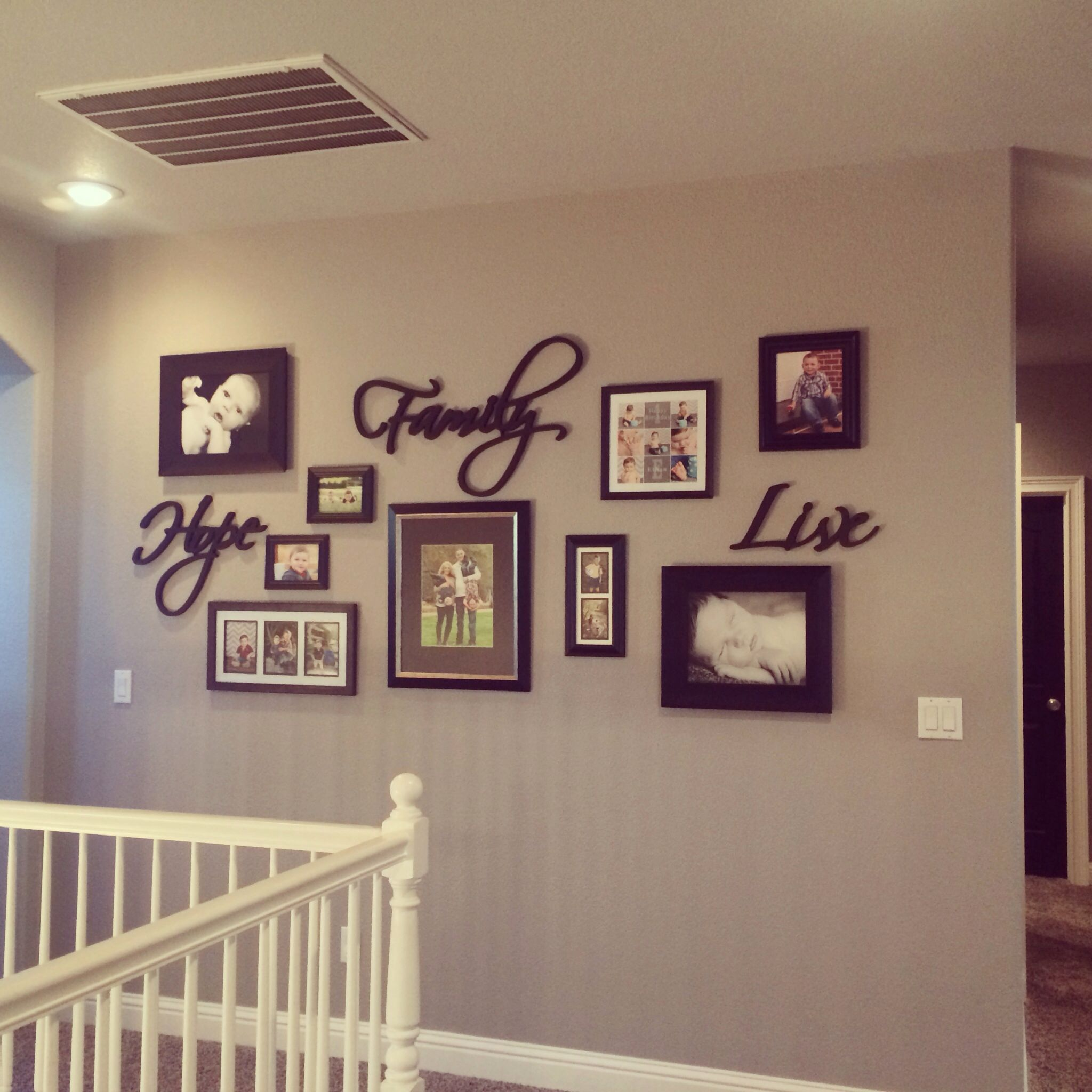 Gallery wall greige walls black doors home decor for Family room picture wall