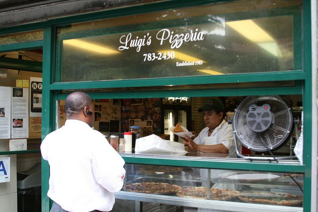 As a student at Pratt Institute, I ate my far share of Luigi's in Clinton Hill, Brooklyn.  Crisp thin crust, sweet sauce, so good...
