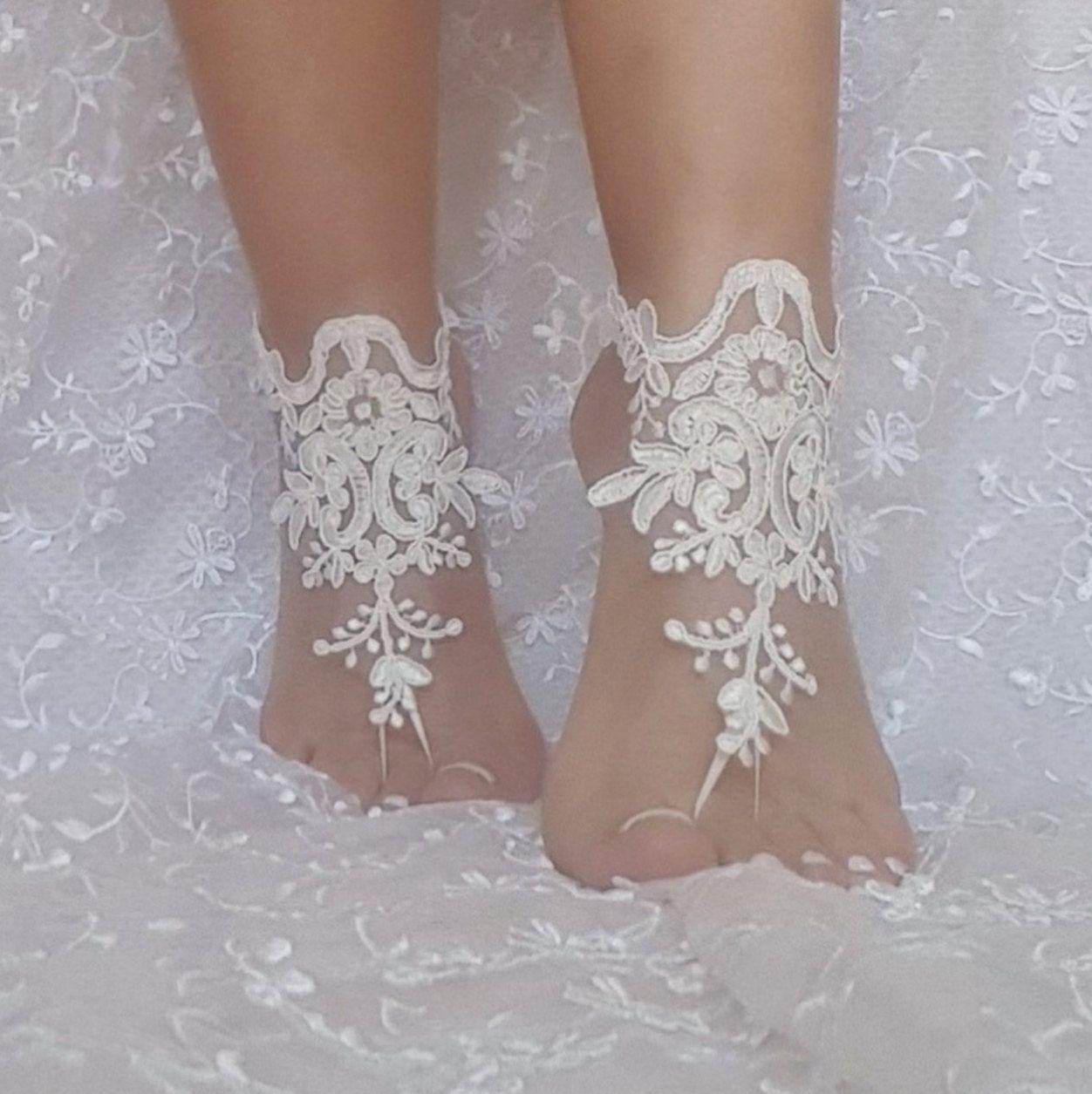 f90f5ff78377 Ivory beach wedding barefoot sandals
