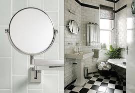 Specchio ovale in acciaio pavimento bianco e nero bagno