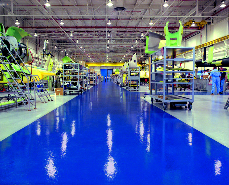 Stonhard's Stonclad GS seamless floor in a helicopter hangar. This troweled, epoxy mortar system provides superior impact and abrasion resistance in a heavy duty environment.