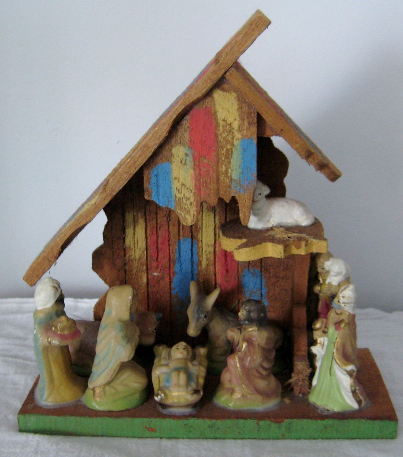 vintage chalkware nativity attached to wooden manger