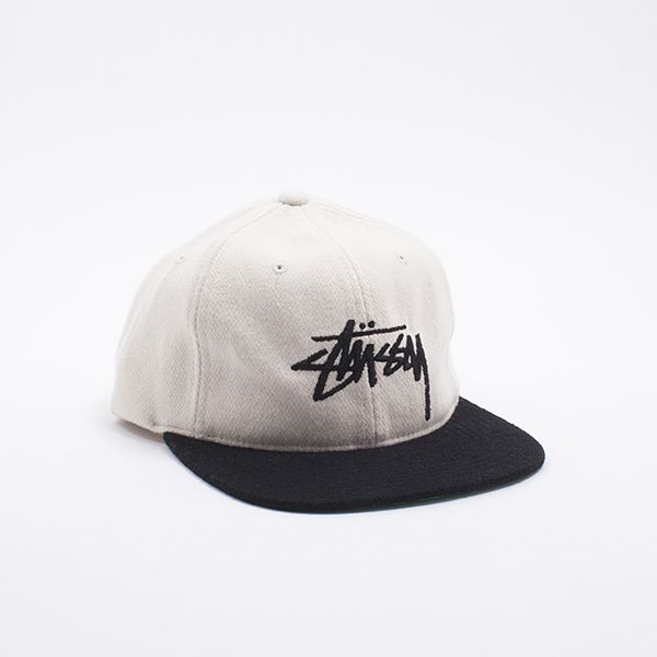 a9d64176d61 Stussy Stock Wool Strapback Cap Standard fitting cap with signature script  logo embroidered on the crown.