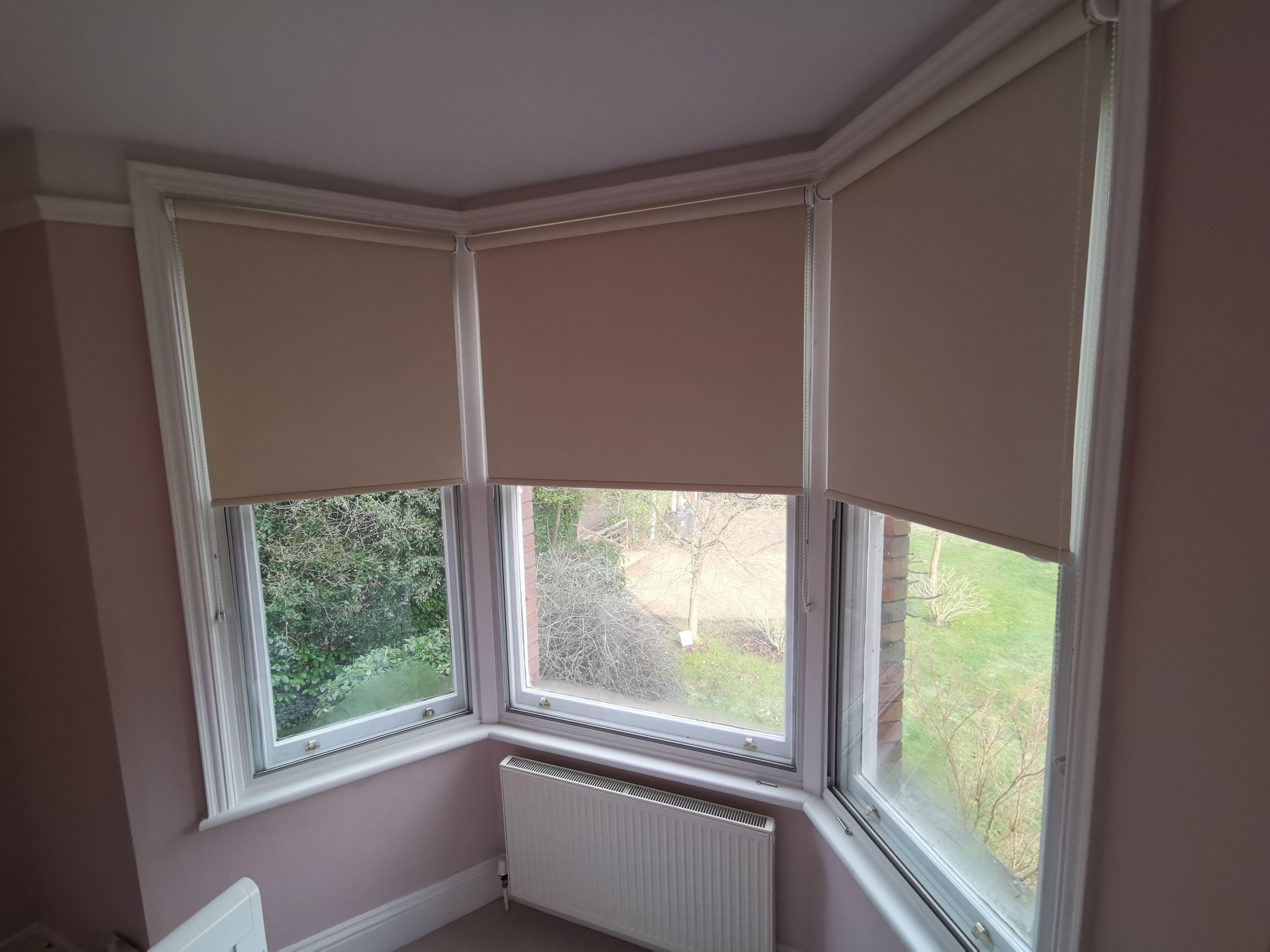 Blackout Roller Blinds For Bay Window In Bedroom In Bishops Stortford Hertfordshire Made To Measure Bay Window Blinds Made To Measure Blinds Vertical Blinds