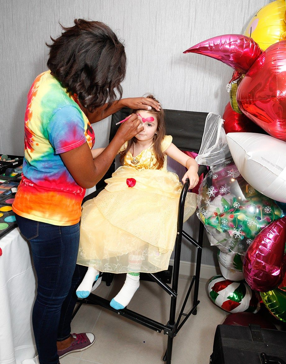 Zelda has her face painted as Minnie Mouse. Party Ideas