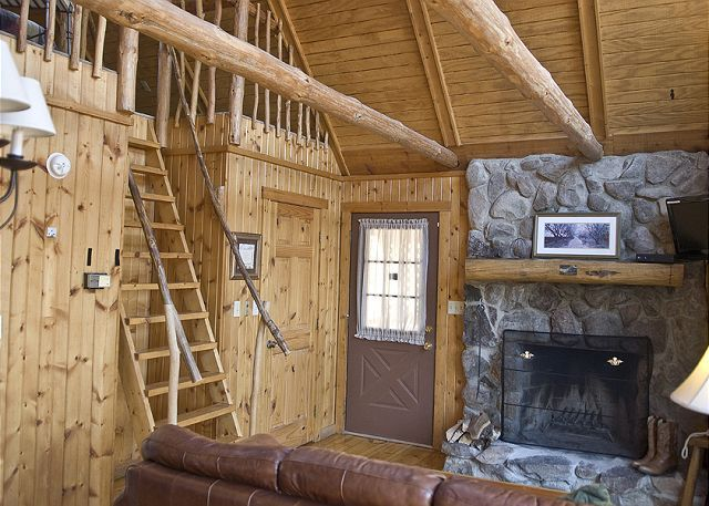 Wooden Cabin With A Lofted Second Bedroom And Warm Stony Fireplace