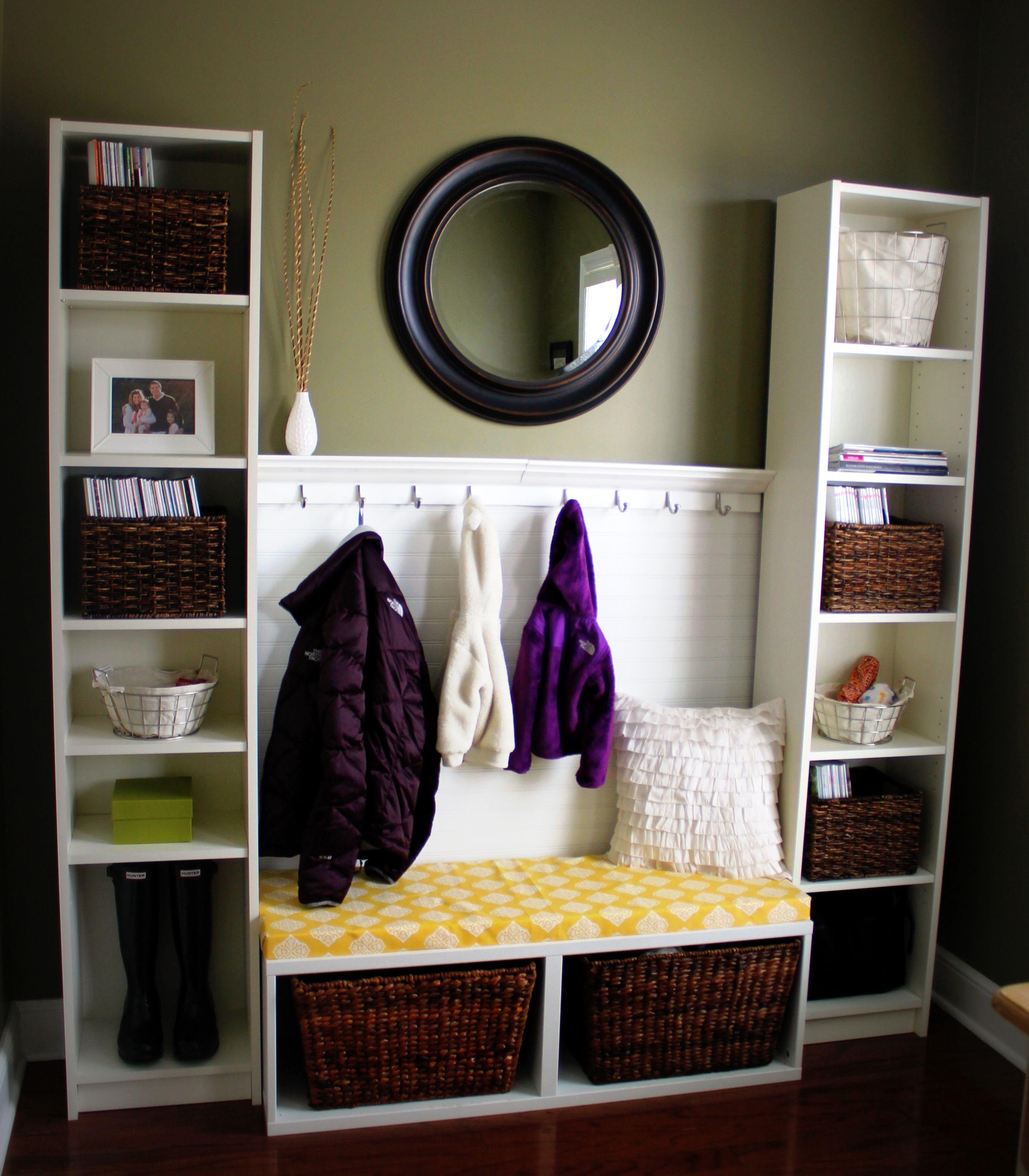 ~ DIY Mudroom Area ~  Created using:  * Bookshelves/Bench from IKEA  * Bead board from Lowe's  * Foam/fabric cushion (JoAnn's)  * 2 sets of hooks w/shelf  * Target mirror/ baskets