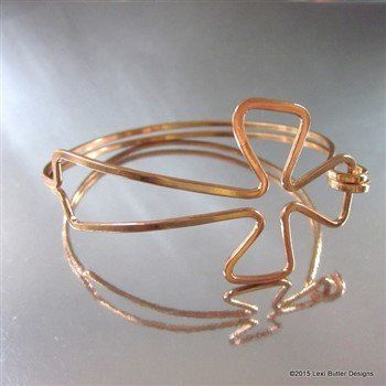 This darling hand crafted cross bangle is sculptured out of of one ...