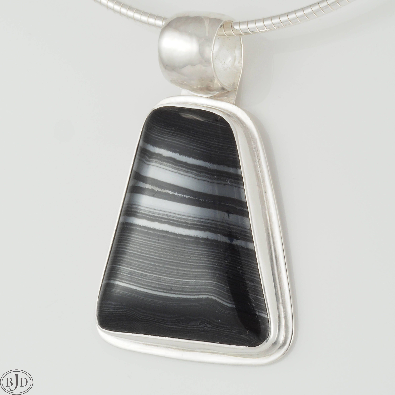 Psilomelane pendant bezel set in argentium sterling silver