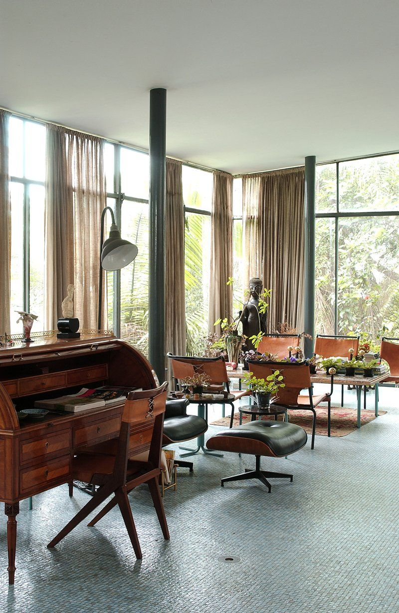 Lina bo bardi photo 8 of 14 the living area of the glass house held many of bo bardis furniture designs including the desk chair and dining chairs
