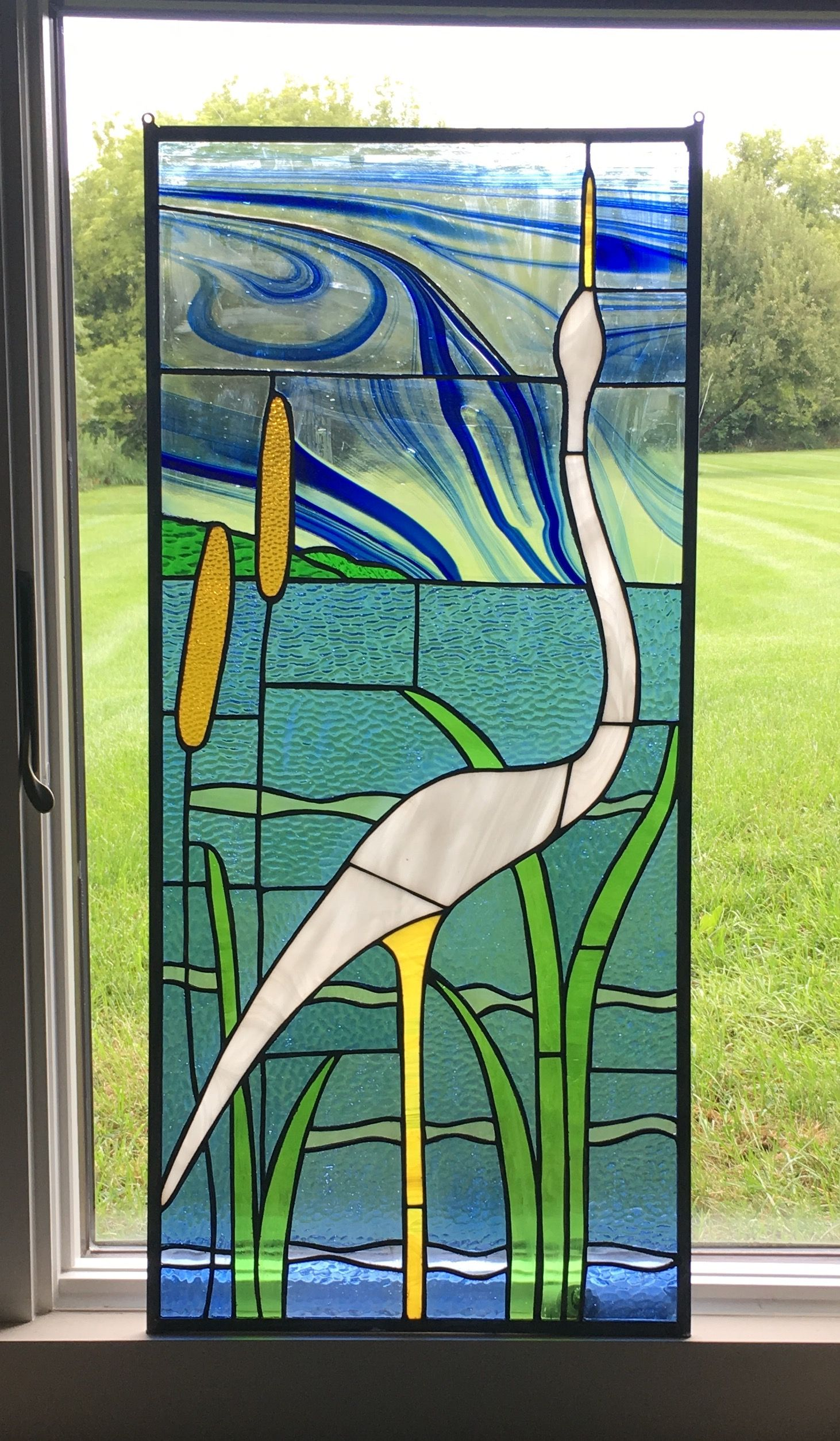 Egret and cat tails stained glass