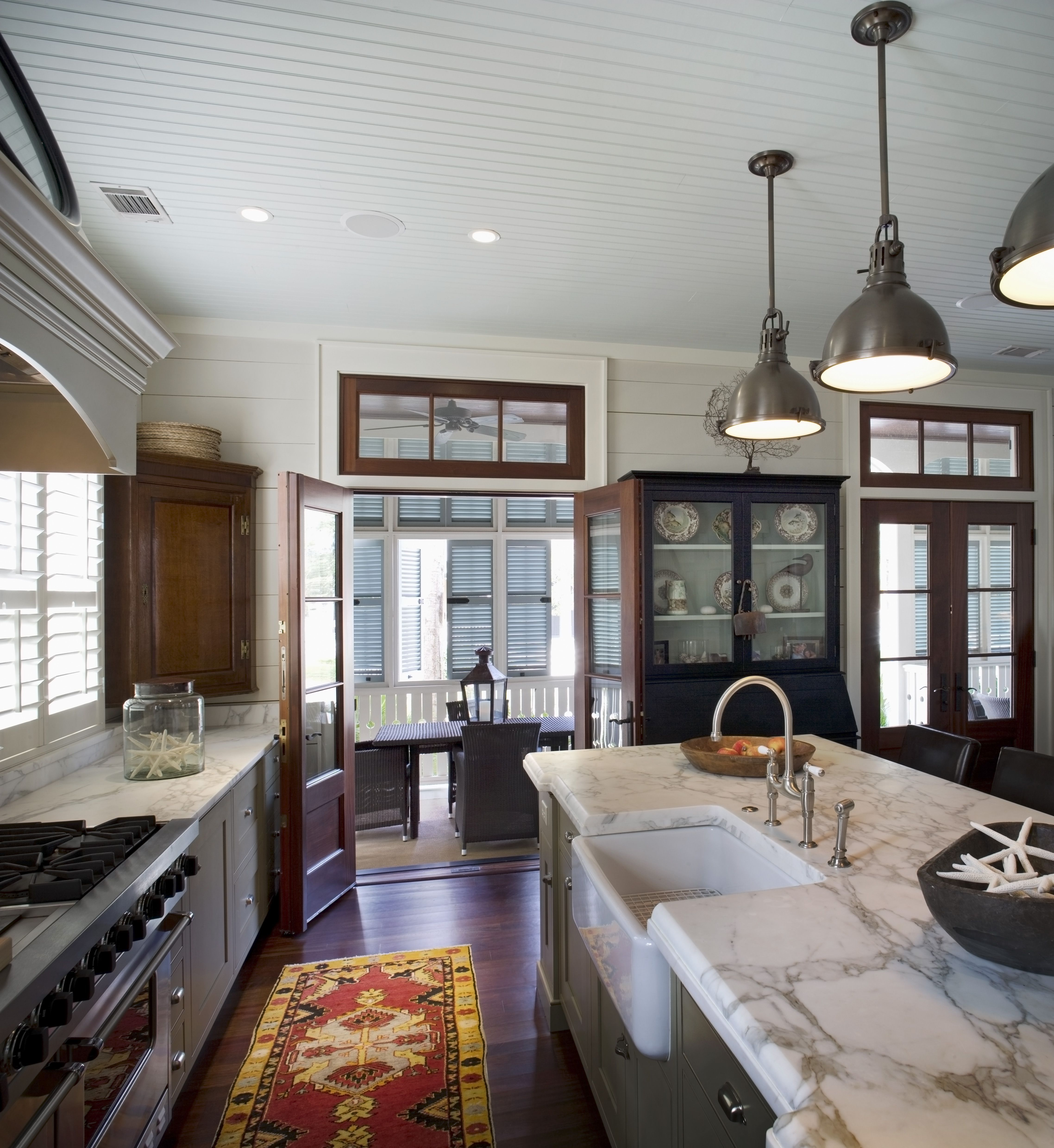 Kitchen in a coastal cottage at Palmetto Bluff marble countertops