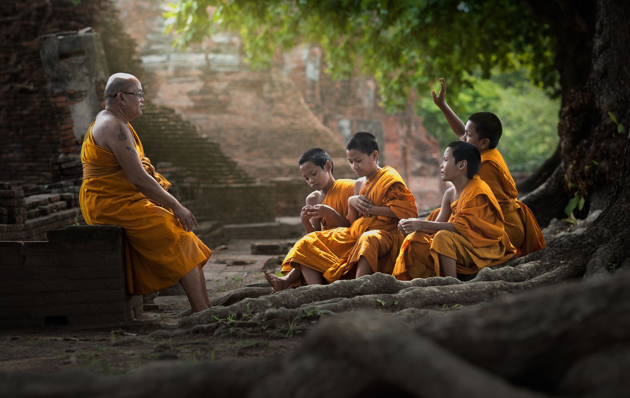 Buddha monk teaching his buddha students in ancient temple ...