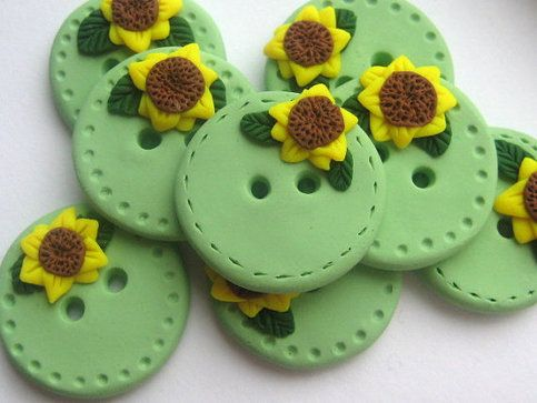 For sale-- Sunflower polymer clay buttons in green by Dolly Madison Designs. #polymer #clay #green #sunflower #creative #art #sculpey #fimo #handmade #sewing #buttons #button