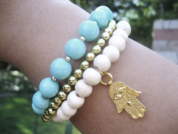 "turquoise, gold & white bracelet with Khamsa (also khmissa/hand of Fatima) symbolizing blessings, power and strength. Worn traditionally to protect against the ""evil eye"""