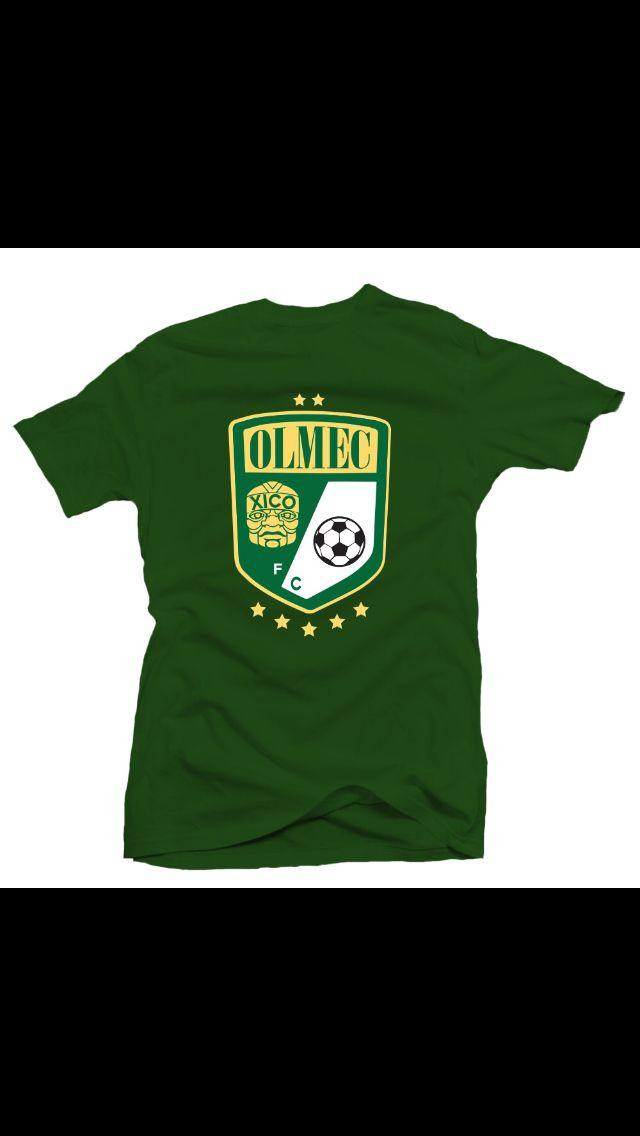 Olmec Futbol club tee on green.