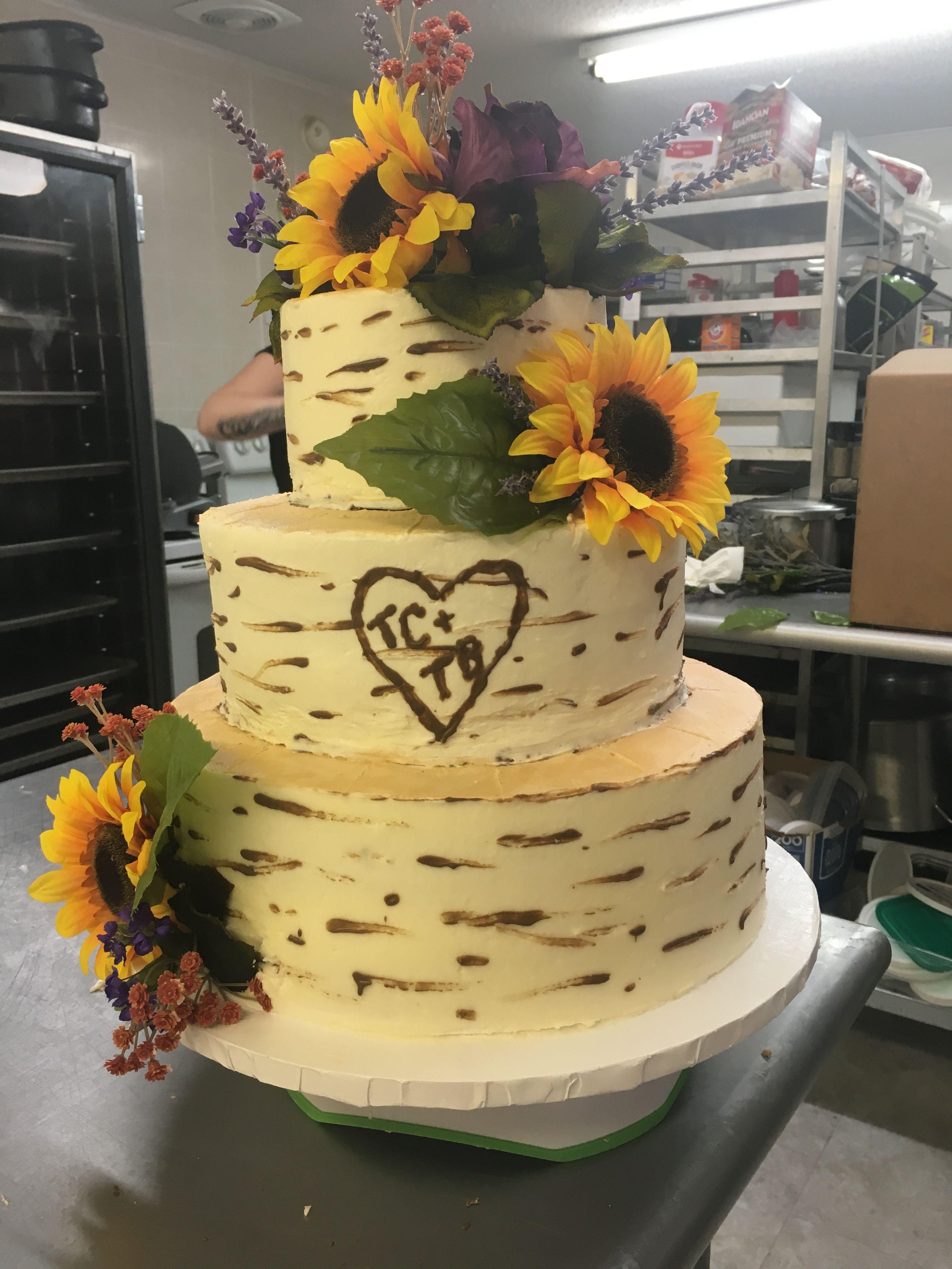 Three tier wedding cake, wood grain look, sunflowers