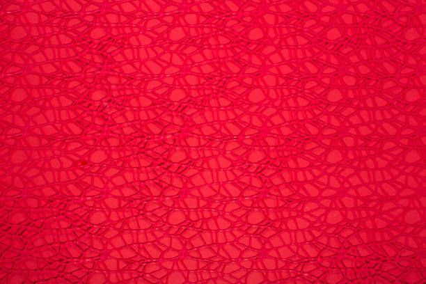 red abstract background of many woven red threads