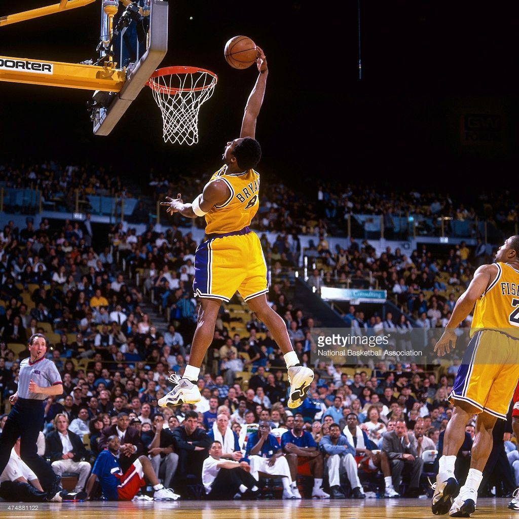 Kobe Bryant #8 of the Los Angeles Lakers attempts a dunk against the Los Angeles Clippers during a game in 1999 at Great Western Forum in Los Angeles, California.