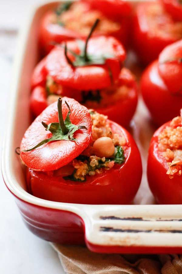 QUINOA AND SPINACH STUFFED TOMATOES - Baked tomatoes stuffed with a quinoa-spinach mixture and topp